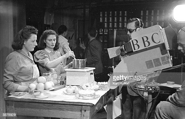 A BBC television cameraman filming the television show 'Designed For Women' Original Publication Picture Post 4543 Never Include A Man pub 1948
