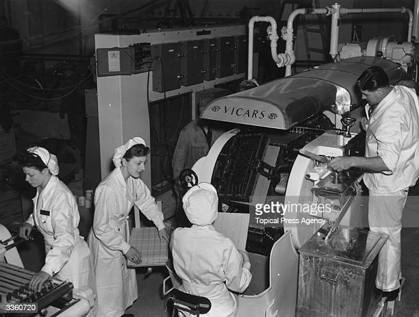 Workers demonstrating the process of making wafers for icecream at the Festival Of Britain's Southbank site in the Power and Production Pavilion...