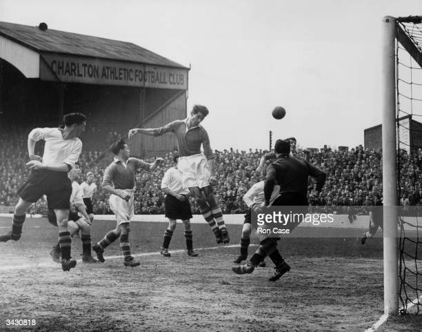 Charlton Athletic footballer John Hewie heading towards goal during a game against Aston Villa
