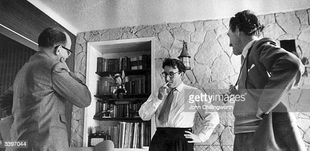 English actor and comedian Peter Sellers at home at Muswell Hill in North London with Bob Muller and photographer Godfrey Thurston Hopkins Original...