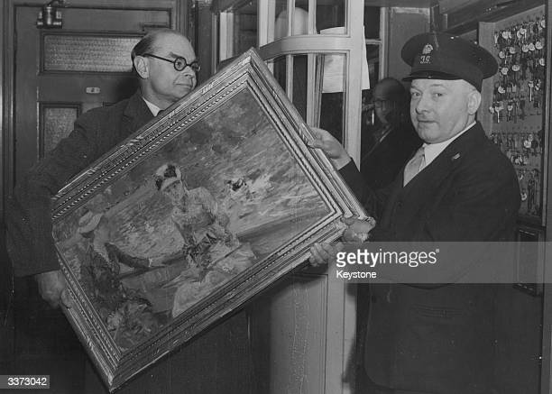 The Director of the Tate Gallery in London Sir John Rothenstein carries the painting 'Jour d'Ete' by Berthe Morisot into the gallery The painting had...