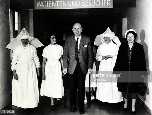 Manchester United Manager Matt Busby leaving the Der Isar hospital Munich with his wife Jean and members of the nursing staff after being injured in...