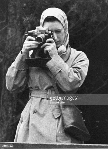 Princess Margaret taking a photograph during the second day of the Badminton Horse Trials