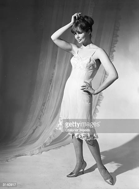 A sixties fashion model wearing a calflength petticoat trimmed in lace by Slenderella