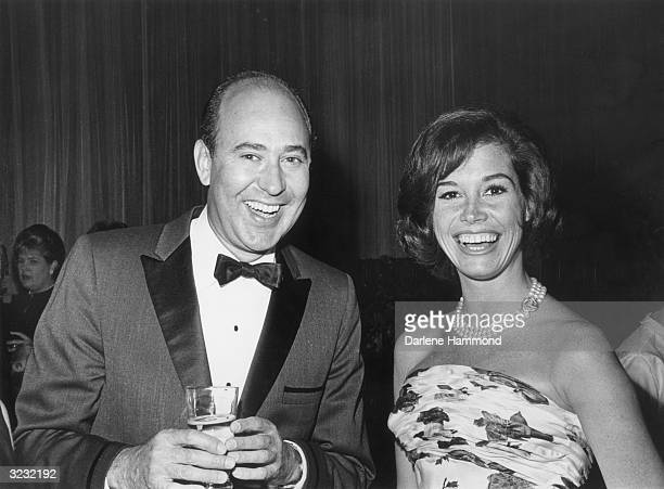 American actors Mary Tyler Moore and Carl Reiner both of 'The Dick Van Dyke Show' smiling at the TV Guide Awards Dinner Hollywood California Carl is...