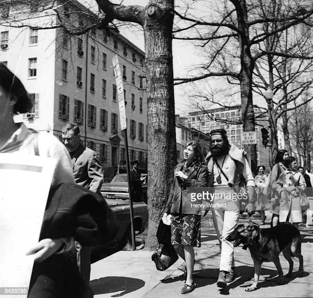 A beatnik couple walking their dog in New York during an antiVietnam War protest