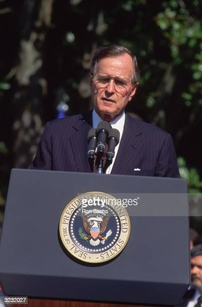 United States president George Bush speaking at a podium at the White House to welcome Nicaraguan President Violeta B de Chamorro