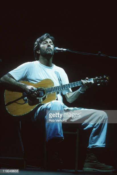 Eric Clapton performs live on stage with acoustic guitar at Ahoy in Rotterdam Netherlands on 17th April 1995