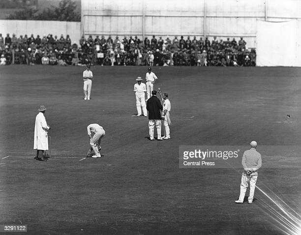 English cricketer Jack Hobbs toasting the crowd with a glass of champagne on equalling W G Grace's record of 124 centuries in first class cricket...