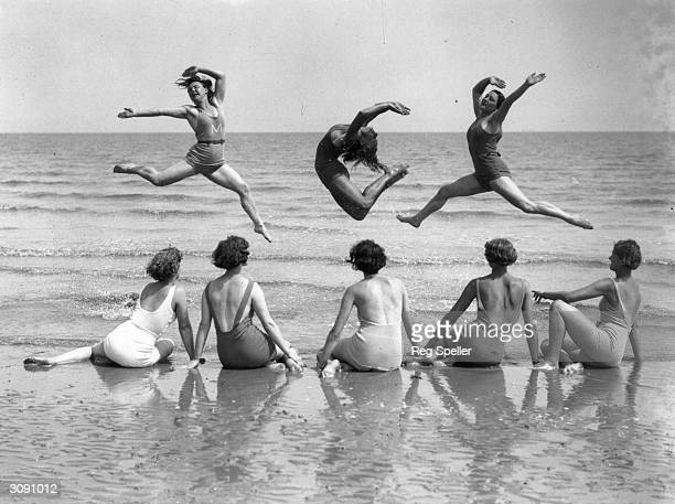Pupils from the International Institute of Margaret Morris Movement practice on the beach at Sandwich on the Kent coast