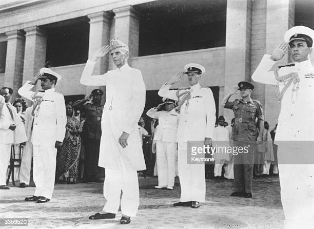 Muhammad Ali Jinnah taking the salute at a military march past in Karachi having been sworn in as the first Governor General of the Muslim Dominion...