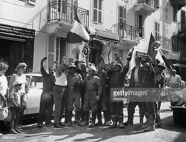 French and Italian construction workers celebrate the completion of the Mont Blanc tunnel connecting Italy and France