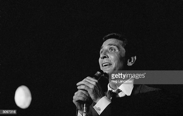 French singer and songwriter Gilbert Becaud born Francois Silly performing on stage