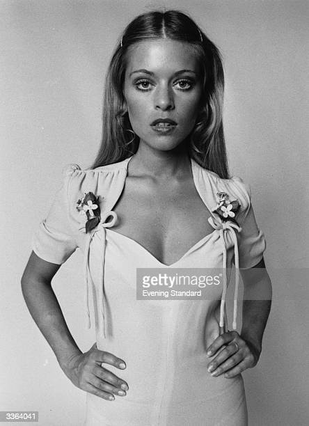 Edina Ronay models a dress by Ossie Clark with sweeheart neckline fake flowers and ruched sleeves sold at Quorum in King's Road London