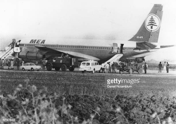 The hijacked Boeing 707 of Lebanon's Middle East Airlines with the safety chutes down at Lydda Airport Israel The plane was hijacked by a...