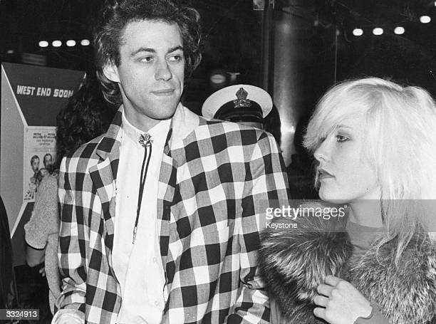 Lead singer of the Boomtown Rats Bob Geldof wife his wife and television producer Paula Yates arriving for the premiere of the film 'Quadrophenia' at...
