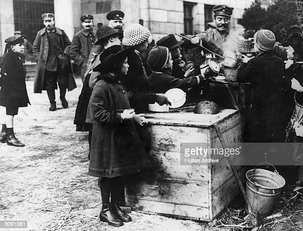 Children at a street kitchen in postwar Germany