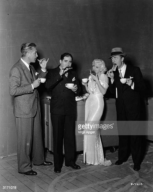 American actress Jean Harlow on the set of the MGM musical melodrama 'Reckless' with director Victor Fleming and costar William Powell
