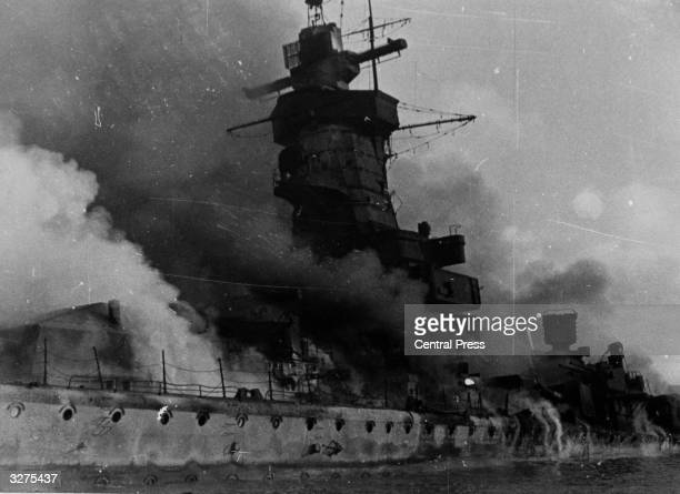 The German battleship 'Admiral Graf Spee' on fire near Montevideo having been scuttled by its crew after the Battle of the River Plate