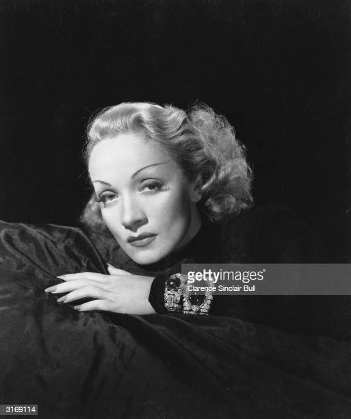Germanborn actress Marlene Dietrich wearing a jewelencrusted bracelet