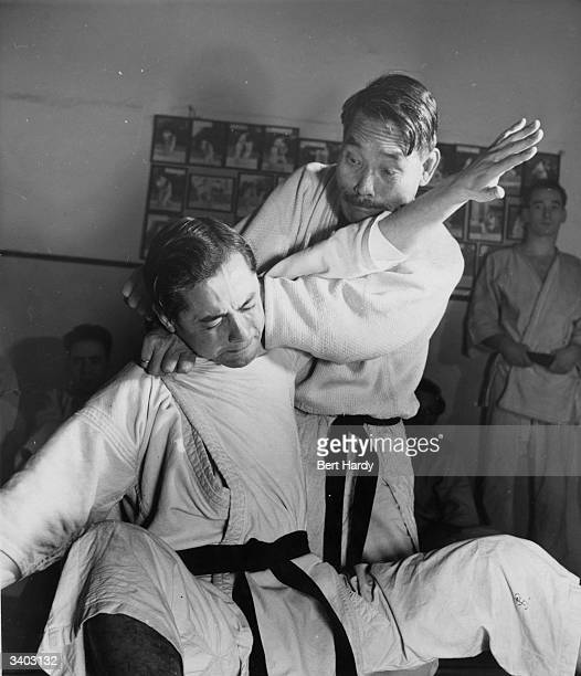 At the Budokwai Club London 63 year old Gunji Koizumi a leading exponent of Judo in Great Britain tackles an opponent Original Publication Picture...