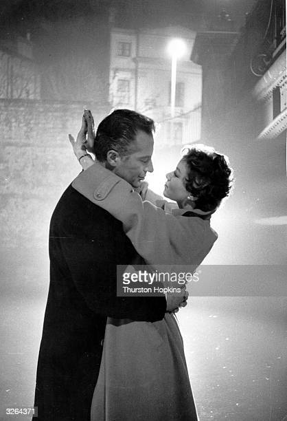 Rossano Brazzi the Italian screen lover and idol with Jennifer Buckle in a scene from the film 'Loser Takes All' being filmed at Shepperton Studios...