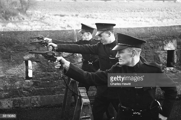 Recruits to the Royal Ulster Constabulary at revolver practice at the RUC Training Barracks at Enniskillen County Fermanagh Northern Ireland Original...