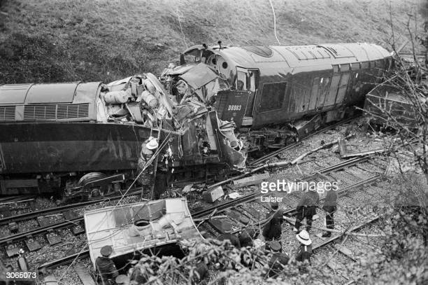 Rescue workers at the scene of a train crash at Bridgend in Glamorgan The driver and one of the firemen died in the accident