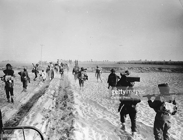 Indian troops advancing into the East Pakistan area during the IndoPakistani war