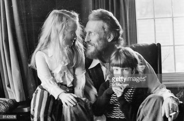 British rocker Ginger Baker who made his name as the drummer in Cream at home with his children