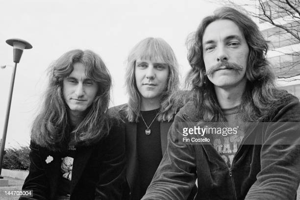 Bassist Geddy Lee Guitarist Alex Lifeson and drummer Neil Peart from Canadian progressive rock band Rush posed in Cleveland Ohio on 17th December 1977