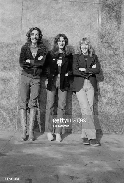 Drummer Neil Peart Bassist Geddy Lee and Guitarist Alex Lifeson from Canadian progressive rock band Rush posed in Cleveland Ohio on 17th December 1977