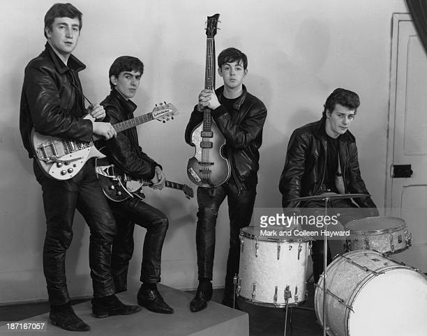 The Beatles pose wearing leather jackets and trousers during their first professional photography session with local wedding photographer Albert...