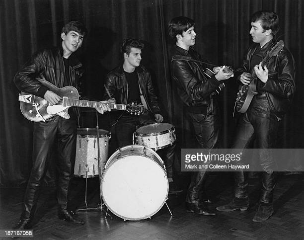17th DECEMBER: The Beatles pose wearing leather jackets and trousers during their first professional photography session with local wedding...