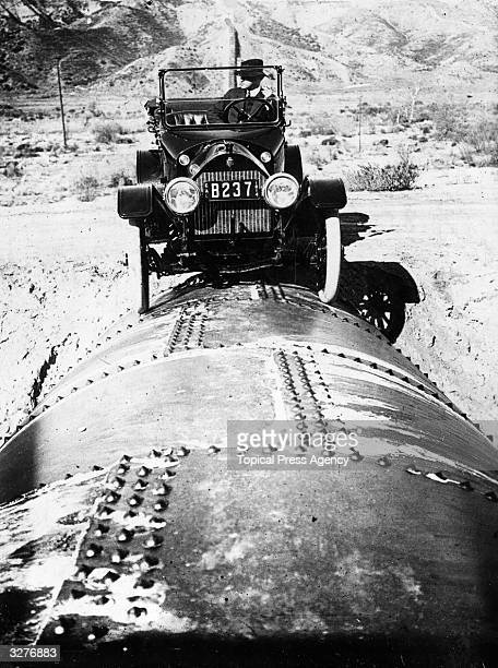 Mr Bert Dingley driving a car along a section of the immense aqueduct of Los Angeles in California