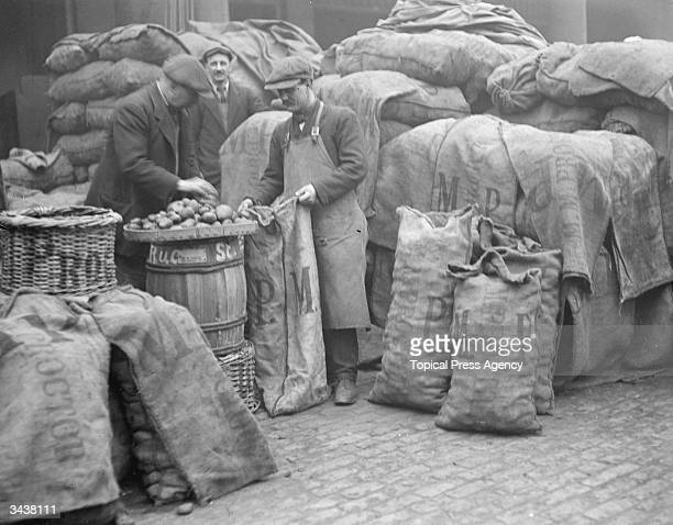 Men sorting sacks of potatoes as the country faces food shortages