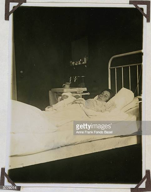 EXCLUSIVE Edith Frank the mother of Anne Frank lies in bed holding her newborn daughter Margot Frankfurt am Main Germany Taken from the photo album...