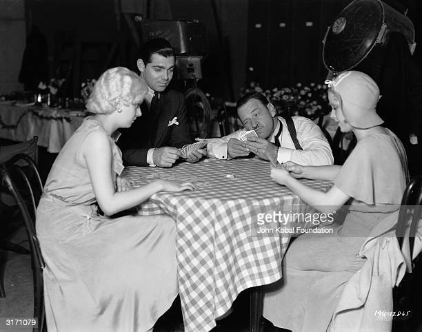 Left to right Jean Harlow Clark Gable Paul Hurst and Mary Carlisle playing cards in a scene from 'The Secret Six' directed by George W Hill