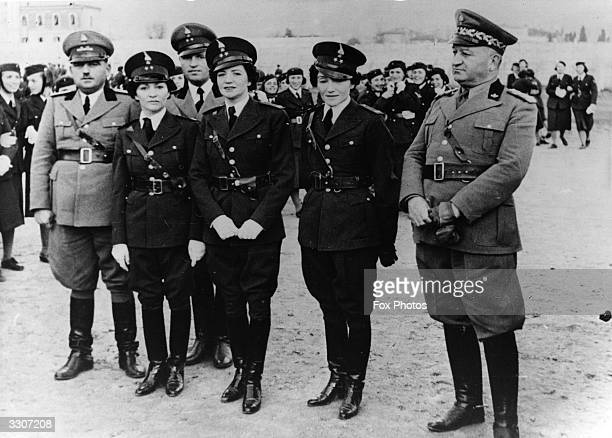 Three Royal Princesses of Albania the sisters of King Zog stand with commanding officers of the Girls' Battalion From left to right they are Ruhije...