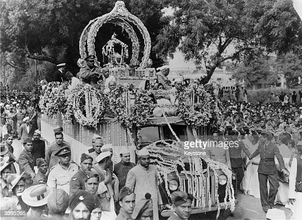 The ashes of assassinated Indian nationalist leader Mahatma Gandhi being carried through the streets of Allahabad before being consigned to the River...