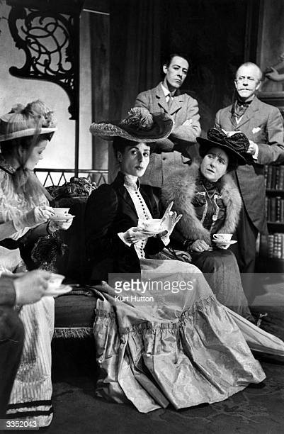 Scene in a production of Shaw's play Pygmalion at the little Embassy Theatre, Swiss Cottage, London. From left to right are: Pat Sandys ; Yvonne...