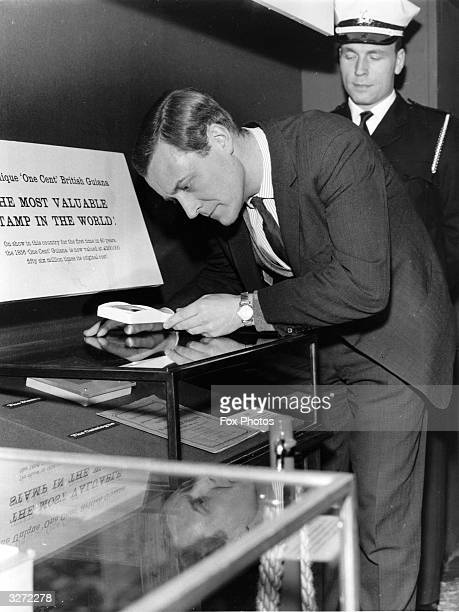 Anthony Wedgwood Benn MP Postmaster General examining stamps when he opened the Stanley Gibbons Stamp Catalogue Centenary Exhibition in the Royal...
