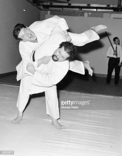 Roger Moore practices judo at Elstree Studios with teacher Barrie Shaigum in preparation for his fight scenes in episodes of ' The Saint', the...