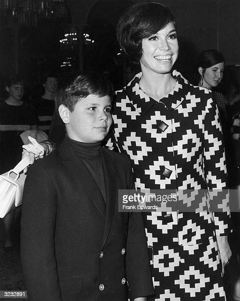 American actor Mary Tyler Moore puts her arm around her son, Richard Meeker Jr , at a Teach Foundation benefit. Moore is wearing a dress with...