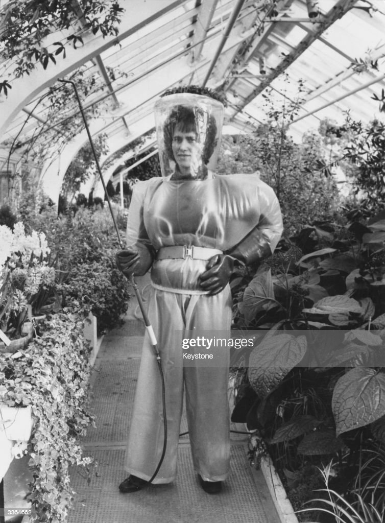 Sophia Pienkos, a gardener at Kew Gardens, London, wearing a space-age suit to protect her when using toxic spray and to keep her cool in the 80 degree heat.