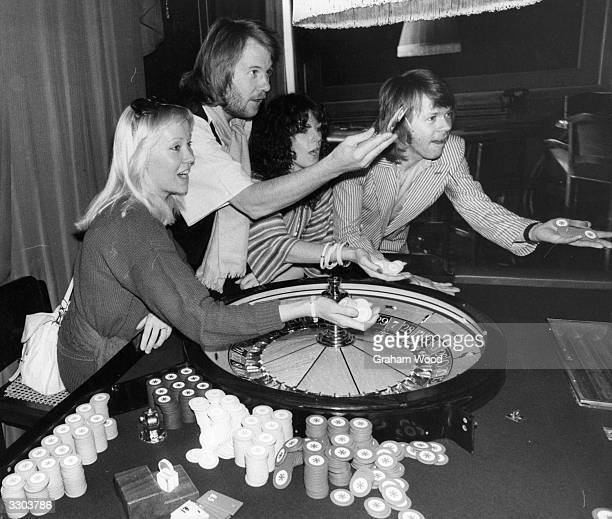 Pop Swedes Abba place their roulette bets during a photo shoot in a casino