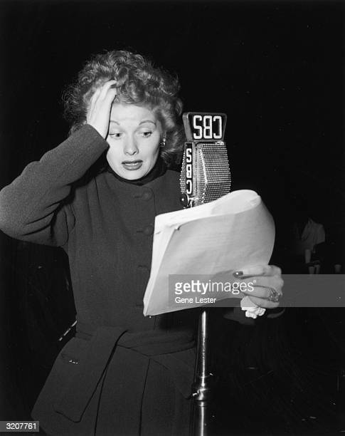 EXCLUSIVE American actor Lucille Ball performing from a script in front of a microphone on the CBS radio show 'Suspense' USA Ball is wearing a...