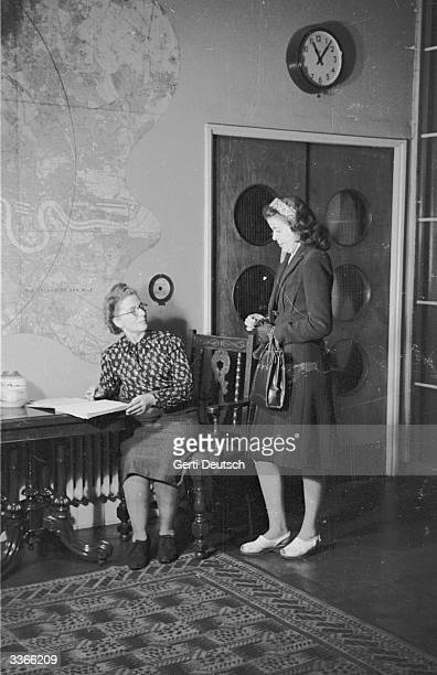 A young woman coming in after the curfew of eleven o'clock at a Cecil House one of a series of lodging houses which are run by a charity formed by...