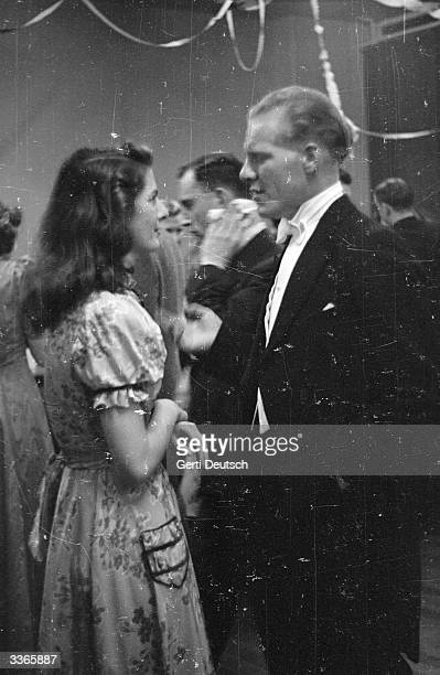 A young women with her dancing partner during a dance at a Cecil House one of a series of lodging houses which are run by a charity formed by the...