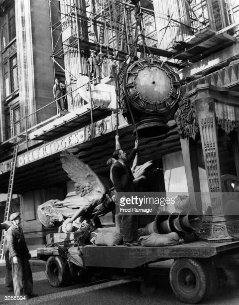 The Selfridges clock is returned to its usual place after having been removed in order to accommodate coronation celebration decorations.